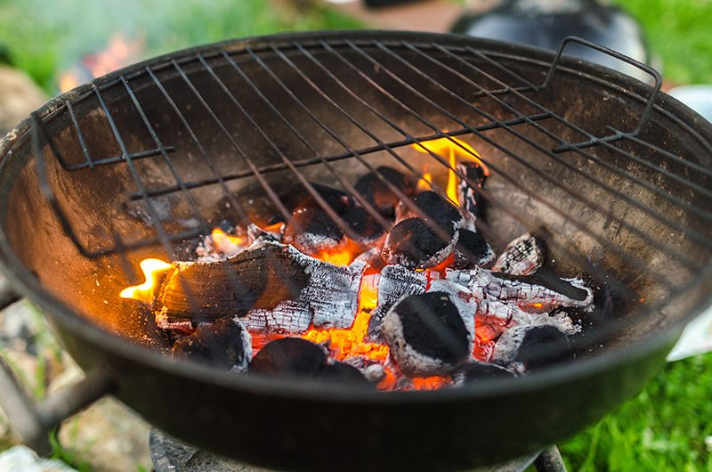 Grill with burning charcoal