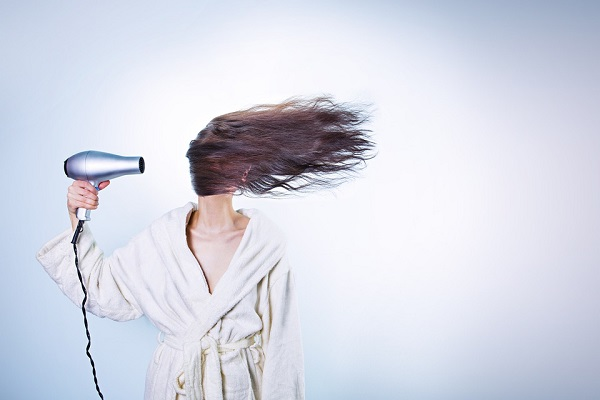 avoid blow drying hair to control frizz