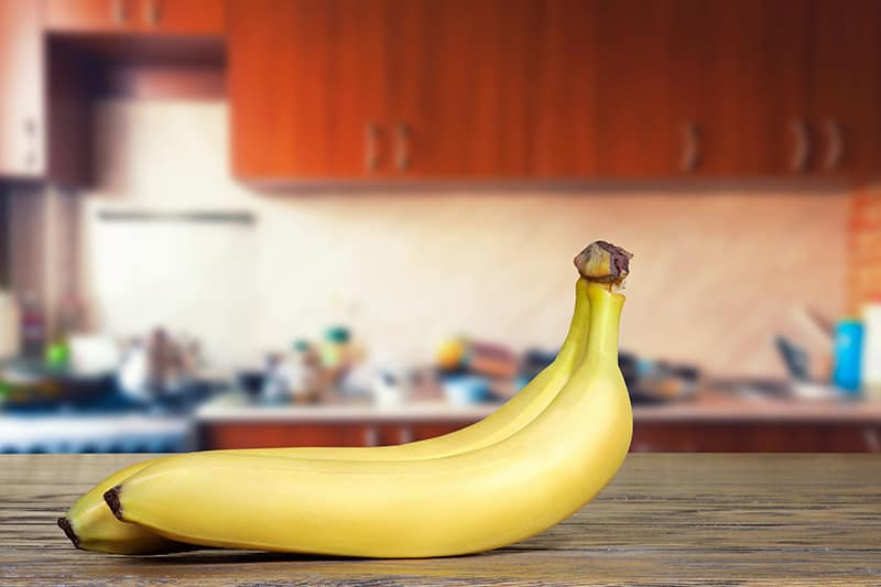 Two bananas on countertop
