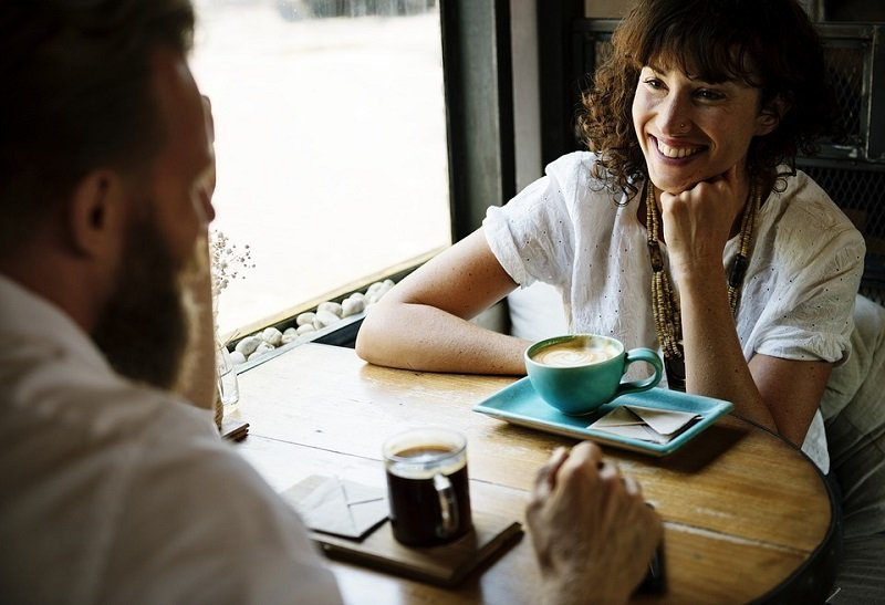 man and woman talking smiling date