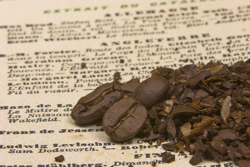 History of caffè latte explained with coffee beans on paper