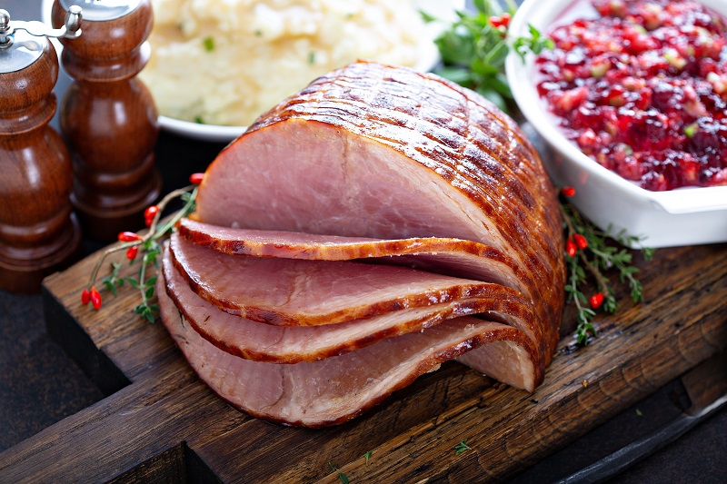 Holiday glazed ham for Christmas dinner with cranberry sauce