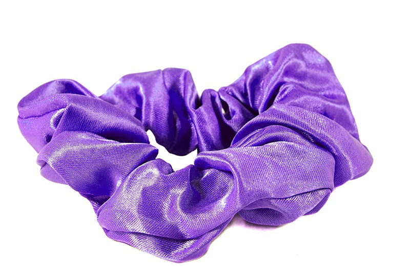 Shiny purple scrunchie for tying hair back, isolated on white background