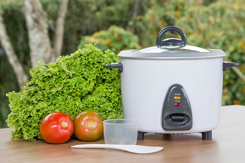 White rice cooker and vegetables
