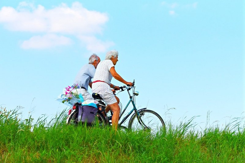 couple cycling elderly people on bikes