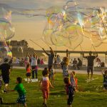 kids and adults have fun making bubbles
