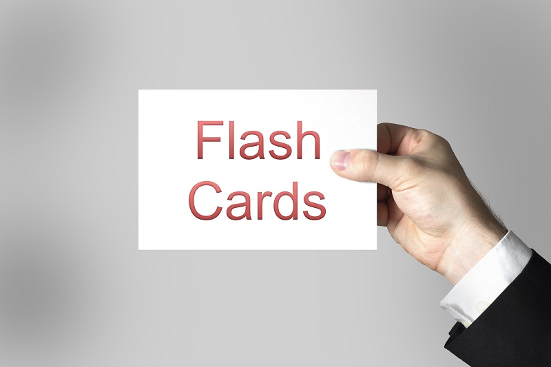 hand holding sign flash cards online learning