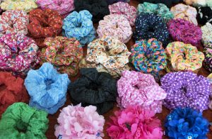 Textile scrunchy. Elastic bobble hair bands. Modern style multi-color mix pattern. Colorful mix for background