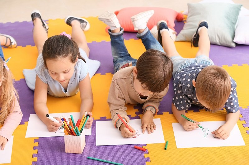 Cute little children drawing in kindergarten