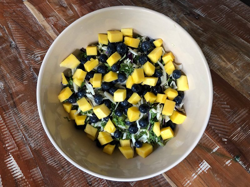 Mango salat with blueberries and cabbage