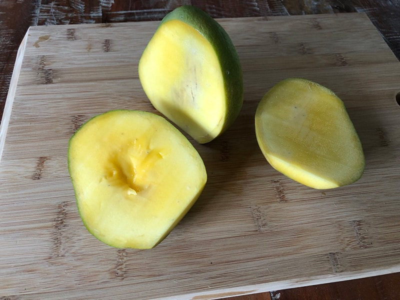 Mango cut into two large pieces
