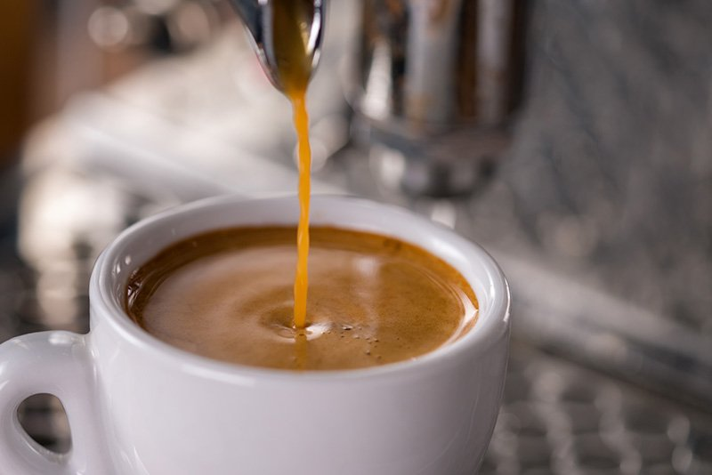 Pour espresso over the hot water