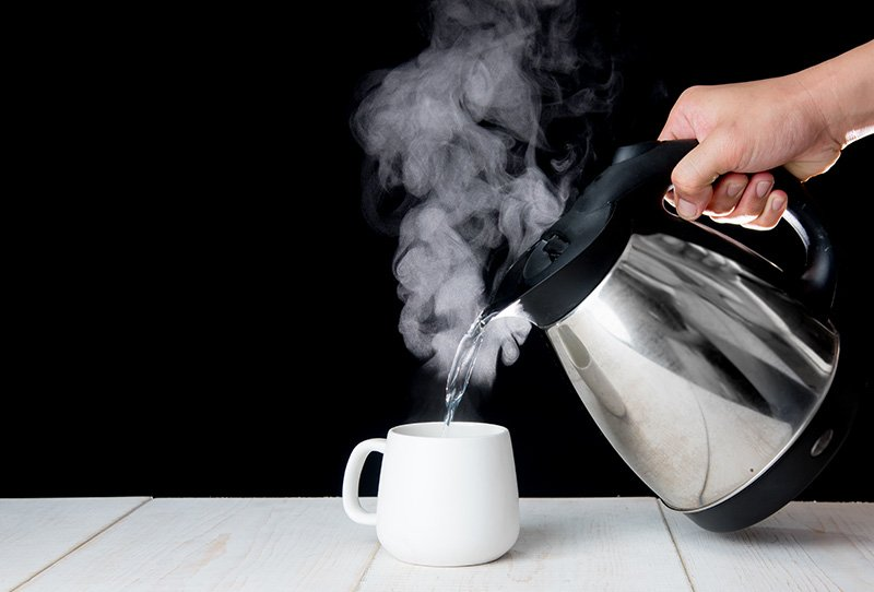 Fill cup with hot water