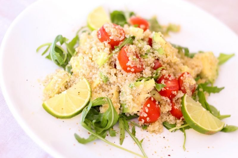 delicious quinoa with tomatoes, lemon slices and greens