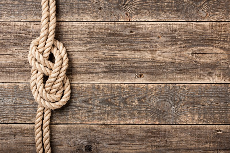 Rope knot on wooden boards