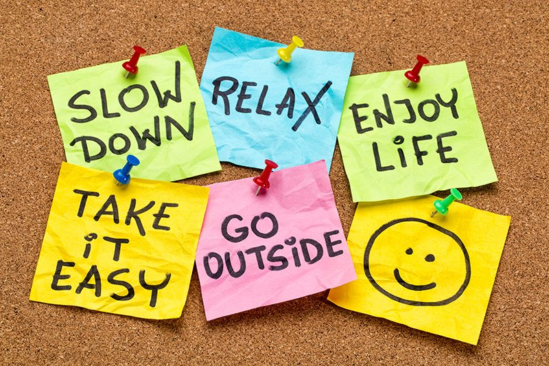 Post its saying slow down, relax, enjoy life, take it easy and go outside with a happy smiley at the end