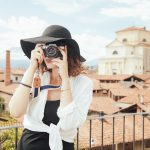 woman takes pictures on travel