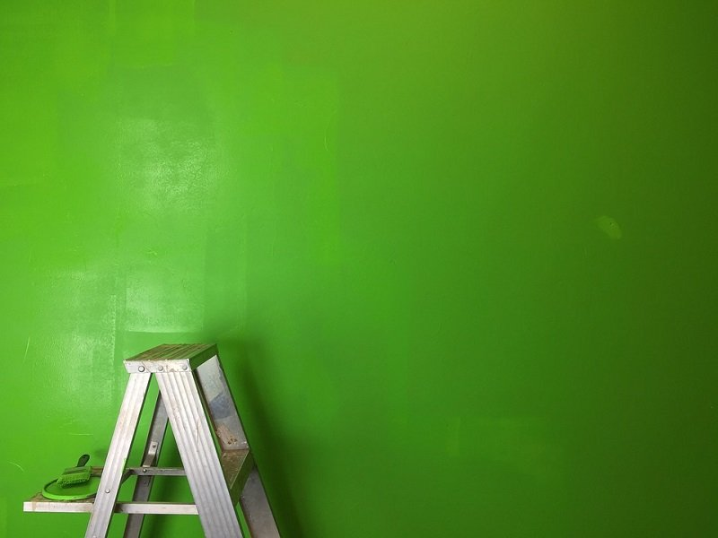 green paint and step ladder against wall