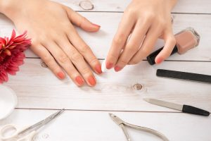 remove nail polish tips female hands manicure