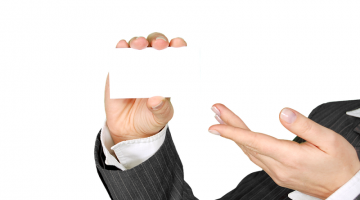 woman holding a blank business card in her hand