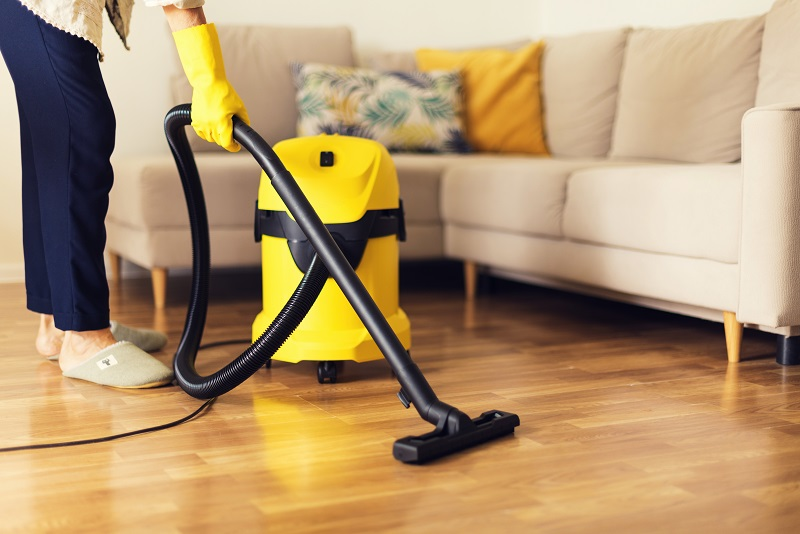 vacuum cleaning with yellow vacuum cleaner