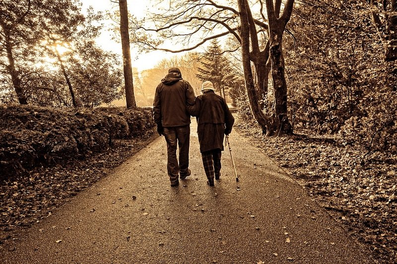 couple elderly old walking evening walk