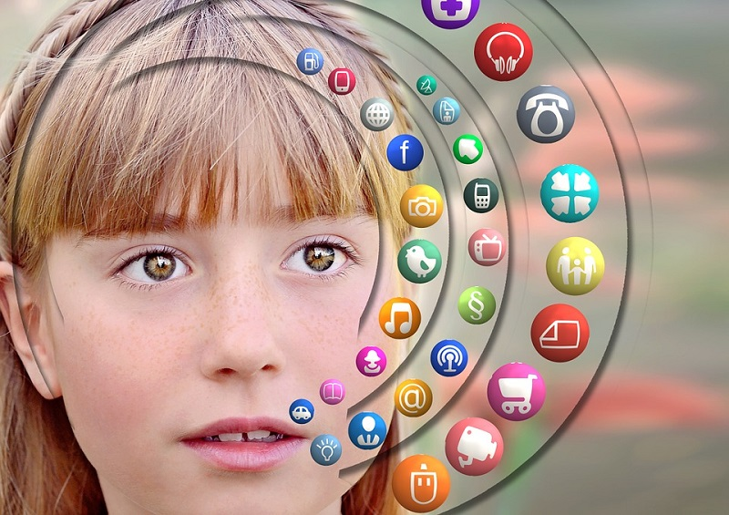 Adolescent girl and social media icons