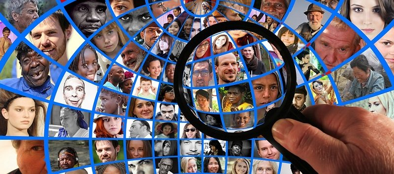 magnifying glass searching people find information on someone