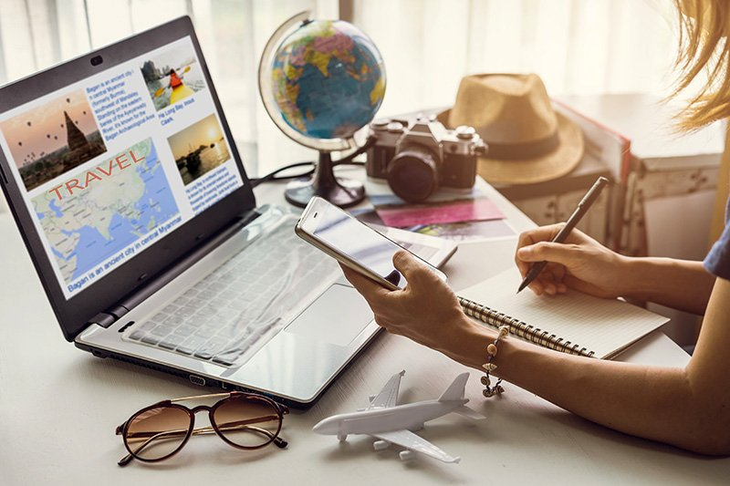 Young women planning vacation and searching information