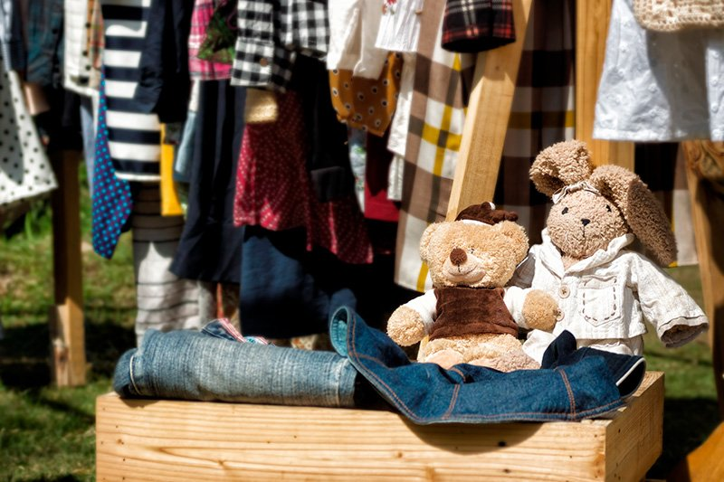 Clothes and stuffed toys at yard sale